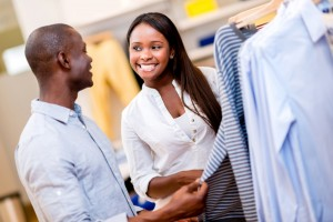 bigstock-Happy-couple-shopping-clothes--49730768