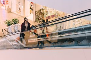 wifi counters - woman shopper on escalator