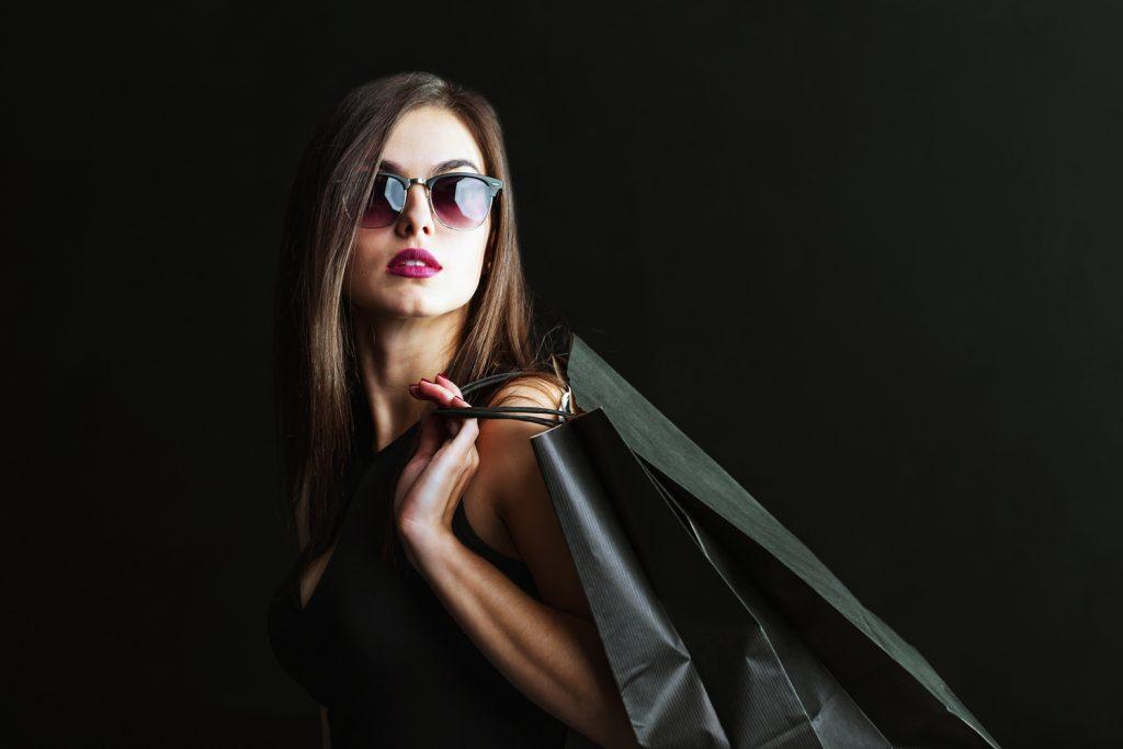 shopper in black dress - personalized retail